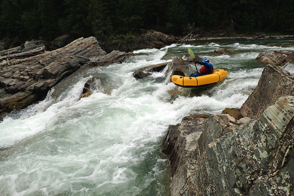 running rapids in a kokpelli packraft